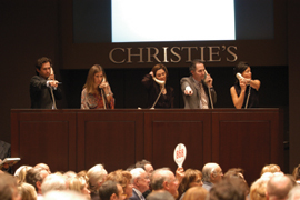 Specialists from Christie's postwar and contemporary art department on the phone with clients and spotting bids in the audience. From left: Barrett White, Amy Gold, Amy Cappellazzo, Brett Gorvy, and Laura Paulson.