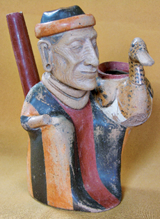 A wrinkled old man with a spout projecting from his back holding a duck displays a high level of artisanship as well as an unusual attention to naturalistic detail.