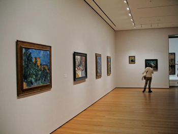 A fifth–floor gallery at MoMA displays Cézannes against walls newly painted Big Bend Beige.