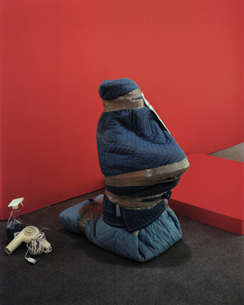 A bundled–up sculpture at the Katonah Museum of Art is the subject of Chad Kleitsch's Untitled #50 (Hostage), 2003.