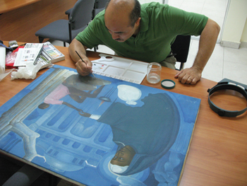 Hitoshi Kimura, a conservator at Art Conservation of Central Florida, treating a painting from the Musée d'Art Nader.