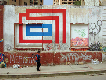 Eltono is known for his colorful geometric box patterns, like this one painted on a wall in Bogotí, 2008.