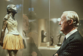 Collector Paul Mellon contemplates the Little Dancer, one of 52 sculptures by Degas he donated to the National Gallery.