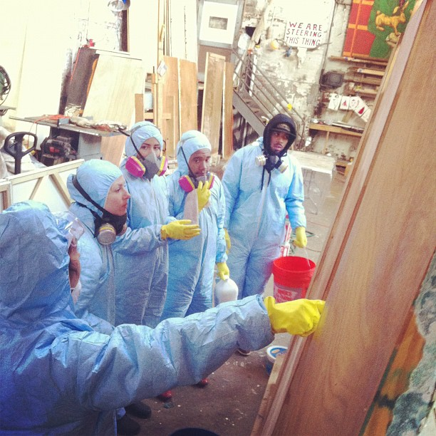 "Studio assistants, family, and friends, including a team from Cre8tive YouTH*ink, are helping to restore paintings in Ray Smith's Gowanus studio, which was inundated with seven feet of water. ""It's like swamp archeology,"" he says."