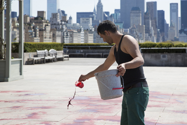 Imran Qureshi creating his site-specific work for The Roof Garden Commission project on The Metropolitan Museum of Art's Iris and B. Gerald Cantor Roof Garden. PHOTOGRAPH: THE METROPOLITAN MUSEUM OF ART/HYLA SKOPITZ