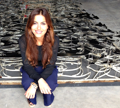 Aida Mahmudova, artist of the Pavilion of Friends of Azerbaijan, standing in front of her Recycled (2012/2013) at the 2013 Venice Biennale. ©ROBIN CEMBALEST 2013. COURTESY THE ARTIST AND YAY GALLERY, BAKU.