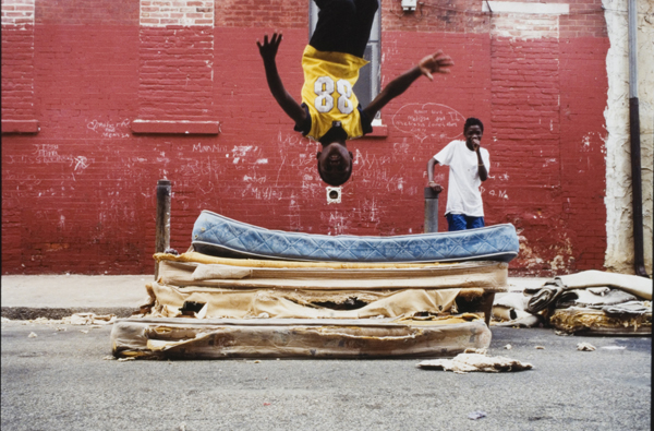 Zoe Strauss, South Philly (Mattress Flip Front), 2001. ©ZOE STRAUSS/COURTESY THE ARTIST AND BRUCE SILVERSTEIN GALLERY, NEW YORK/PHILADELPHIA MUSEUM OF ART, PURCHASED WITH FUNDS CONTRIBUTED BY THEODORE T. NEWBOLD AND HELEN CUNNINGHAM.