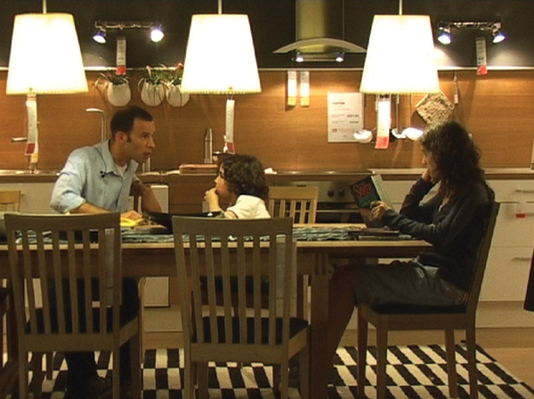 In Guy Ben-Ner's video Stealing Beauty, 2007, the artist and his family pretend to live in IKEA showrooms in a spoof on American sitcoms.
