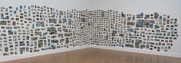 "Ellen Harvey, Pillar-Builder Archive, 2013. ""The Alien's Guide to the Ruins of Washington, D.C."" Approximately 3,000 postcards, acrylic paint, and tape. PHOTO COURTESY CORCORAN GALLERY OF ART."