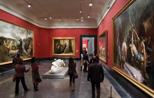 From left: Francisco Pradilla's Juana la Loca, 1877; Lorenzo Vallés, The Madness of Juana Castile, 1866; Alejandro Ferrant, The Burial of Saint Sebastian, 1877.  Center: Agustin Querol, Sagunto, 1886. ©MUSEO NACIONAL DEL PRADO