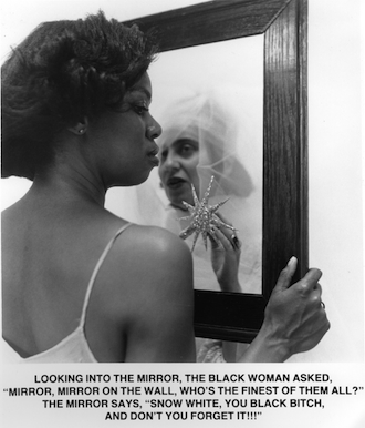 "Carrie Mae Weems, Mirror Mirror, from the series ""Ain't Jokin',"" 1987-1988, gelatin silver print. ©CARRIE MAE WEEMS. COURTESY THE ARTIST AND JACK SHAINMAN GALLERY, NEW YORK."