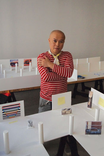 "Phong Bui with a scale model of the upcoming exhibition ""Come Together: Surviving Sandy.""  COURTESY DAVID A. WILLIS."