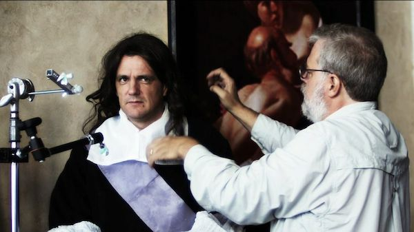 Jenison adjusts the wig on Graham Toms, who modeled as the  gentleman for the painting.  PHOTO: SHANE F. KELLY, ©2013 HIGH DELFT PICTURES LLC, COURTESY OF SONY PICTURES CLASSICS. ALL RIGHTS RESERVED.