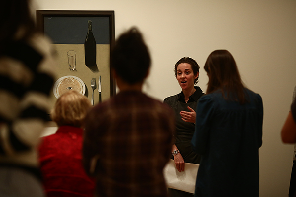 Curatorial assistant Danielle Johnson with The Portrait. EDIBLE MAGRITTE AT THE MUSEUM OF MODERN ART. PHOTO: PAULA COURT.