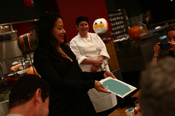 Artist Elaine Tin Nyo demonstrates how to prepare the first dessert.  EDIBLE MAGRITTE AT THE MUSEUM OF MODERN ART. PHOTO: PAULA COURT.