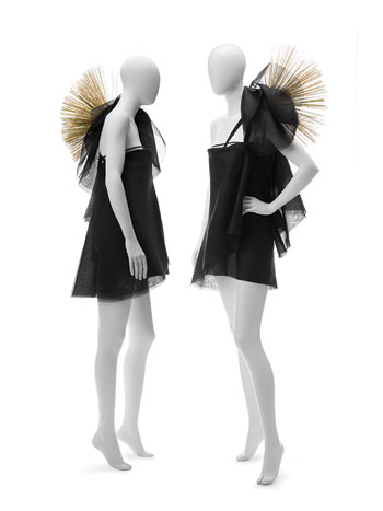 Jean Yu's chiffon dress has shoulder accents made from straw broom bristles and was inspired by David Alvarez's sculpture Porcupine, ca. 1981 (below),  at the American Folk Art Museum in New York. METE OZEREN