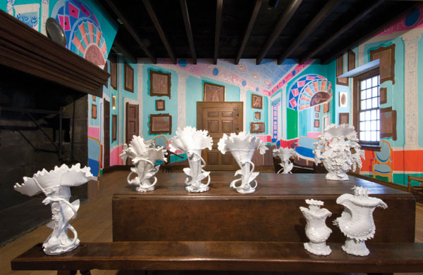 Ann Agee's installation Super Imposition (2010), at the Philadelphia Museum of Art, presents the artist's factory-like castings of rococo-style vessels in a re-created period room. COURTESY PHILADELPHIA MUSEUM OF ART