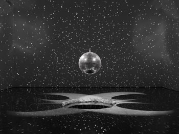 Untitled, 2011, mirror ball, mechanics, and water. RON AMSTUZ