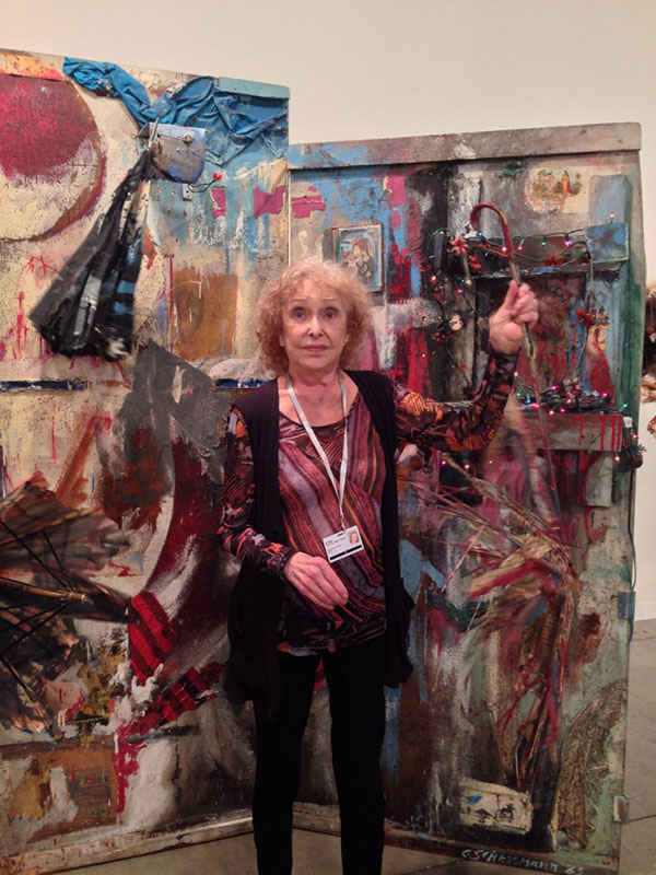 Carolee Schneemann with her 1963 piece Untitled (Four Fur Cutting Boards) at the P.P.O.W. booth at Art Basel Miami Beach.COURTESY THE ARTIST AND P.P.O.W. PHOTO ROBIN CEMBALEST.