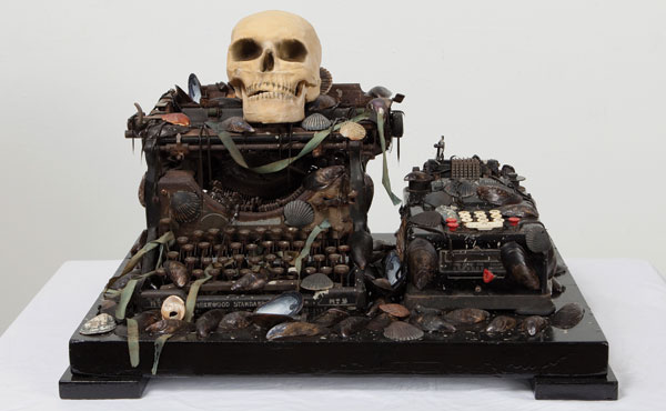 Matthew Benedict includes a skull, a traditional symbol of vanitass, in his mixed-media Apocalyptic Still Life, 2012, which combines seashells with an obsolete calculator and typewriter. JOERG LOHSE/©MATTHEW BENEDICT/COURTESY ALEXANDER AND BONIN, NEW YORK