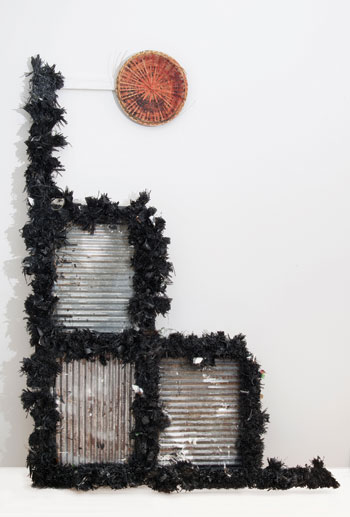 One of Keyser's recent tributes to down-home Southern music: A Blind Torpedo Walks into a Bar, 2013, raffia, enamel, glass, wood, and basket. COURTESY THE ARTIST