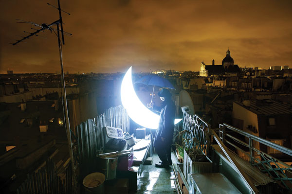 Russian romantic Leonid Tishkov totes his celestial darling around the world.  His Private Moon, 2011, is a plastic-and-LED poetic object.COURTESY ARTS CATALYST, LONDON