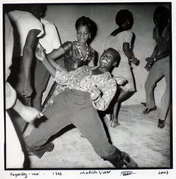 Malick Sidibé, Regardez Moi, 1962/2007, silver gelatin print. © MALICK SIDIBÉ. COURTESY THE ARTIST AND JACK SHAINMAN GALLERY, NEW YORK.