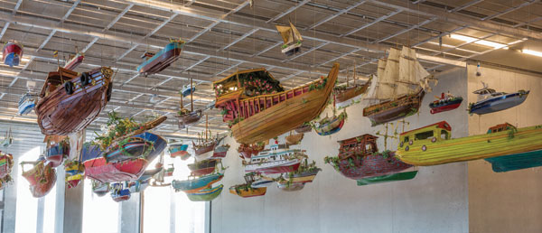 For Those in Peril on the Sea, 2011, an armada of model boats suspended from the ceiling at the Pérez Art Museum Miami. DANIEL AZOULAY PHOTOGRAPHY/COLLECTION PÉREZ ART MUSEUM MIAMI, MUSEUM PURCHASE FROM THE HELENA RUBINSTEIN PHILANTHROPIC FUND AT THE MIAMI FOUNDATION/COMMISSIONED BY THE CREATIVE FOUNDATION FOR THE FOLKESTONE TRIENNIAL/REPRODUCED WITH PERMISSION OF THE ARTIST