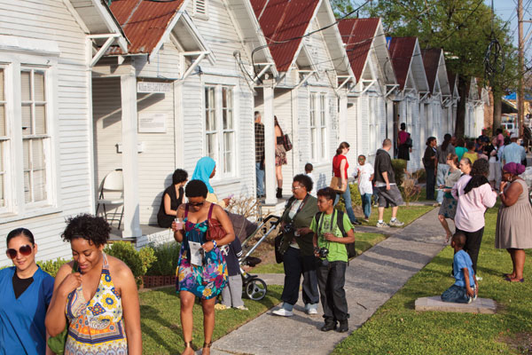 "An art event at Rick Lowe's ""Project Row Houses,"" which has transformed a group of neglected shotgun houses in Houston into an African American cultural hub.ERIC HESTER"