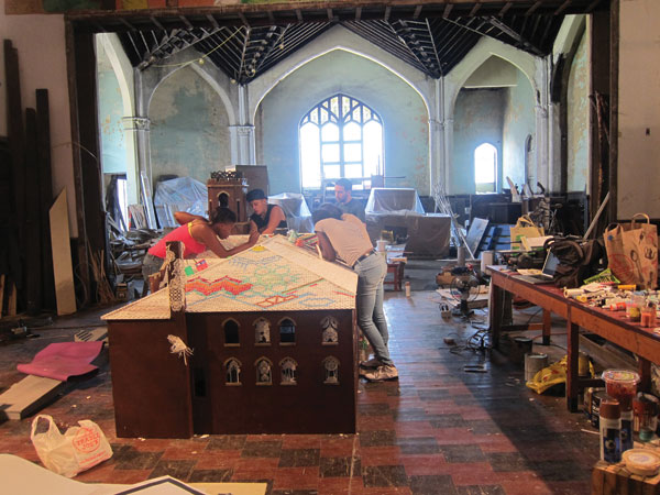 Ceramic-tile makers in an abandoned church in Braddock, Pennsylvania, where the artist Swoon has initiated a revitalization effort. The colorful tiles will provide a new roof for the building. CALEDONIA CURRY