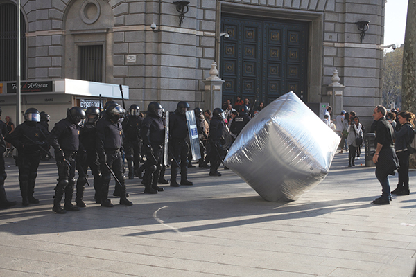 Inflatable cobblestones, created by the Eclectic Electric Collective and Enmedio, protected demonstrators during a general strike in Barcelona, 2012. ©ORIANA ELIÇABE/ENMEDIO.INFO