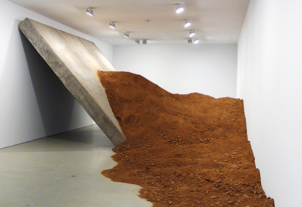 Once Extracted, 2006–2009, looks like a 15-foot slab of concrete that crash-landed post-earthquake, but it actually contains an artful surprise−it is hollow. CAM LA/COURTESY THE ARTIST