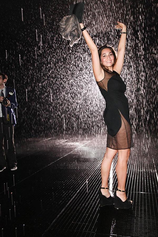Dana Farouki visiting Random International's  Rain Room , 2012, at MoMA.BFA