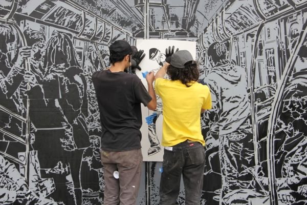 An energetic subway performer gets ignored by subway riders in Icy and Sot's mural.