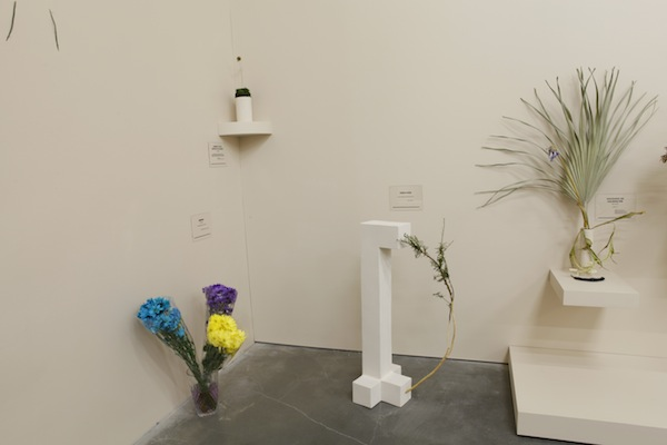 "Installation view of Camille Henrot's ""Is it possible to be a revolutionary and like flowers?"" at the New Museum, 2014. Includes (from left to right): ""Amerika,"" Franz Kafka, ""Journey to the Center of the Earth,"" Jules Verne, ""Moby-Dick; or, The Whale,"" Herman Melville, and ""Discourse on Colonialism,"" Aimé Césairem all 2012-2014.  COURTESY NEW MUSEUM, NEW YORK. PHOTO: BENOIT PAILLEY."
