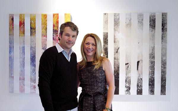 Alden and Janelle Pinnell with paintings by Israel Lund. GREGORY RUPPE