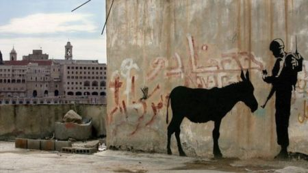 Two Banksy Murals Head Auction with