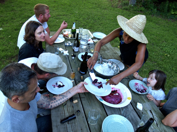 Members of the Denniston Hill artist collective share a meal. ©TIMOTHY GERKEN.