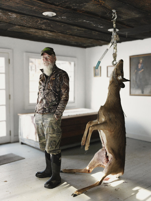 Mike Osterhout in his studio with a deer. COURTESY THE ARTIST.