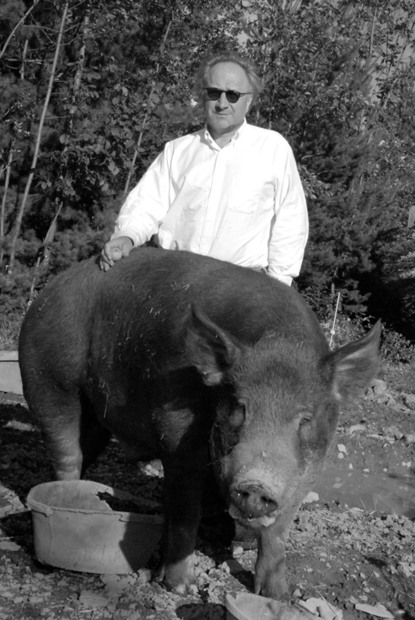 Peter Nadin with his great boar, Abe, at Old Field Farm. COURTESY THE ARTIST.