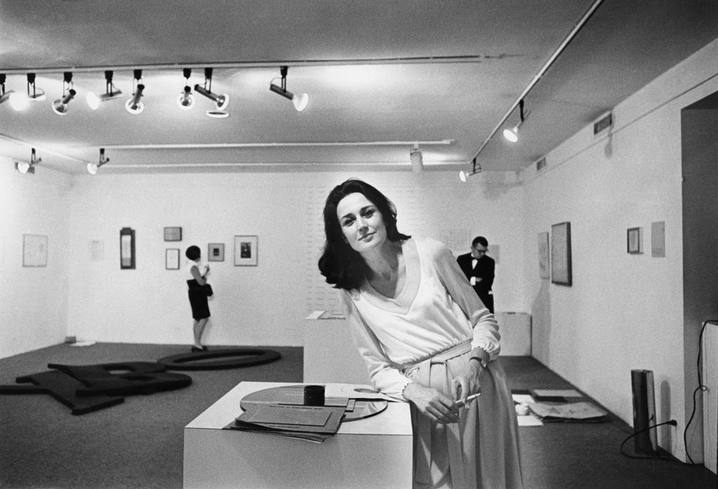 "Virginia Dwan at the exhibition ""Language III,"" 1969, at Dwan Gallery, New York. ROGER PRIGENT/COURTESY DWAN GALLERY ARCHIVE"