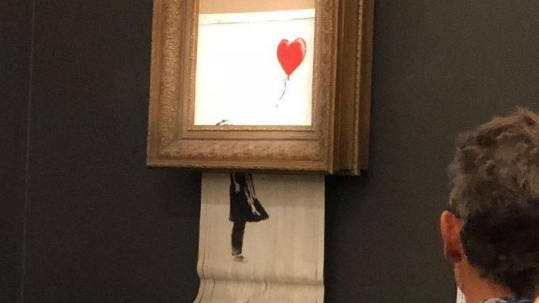 Banksy Painting Self-Destructs After Selling for $1.4 M. at Sotheby's London
