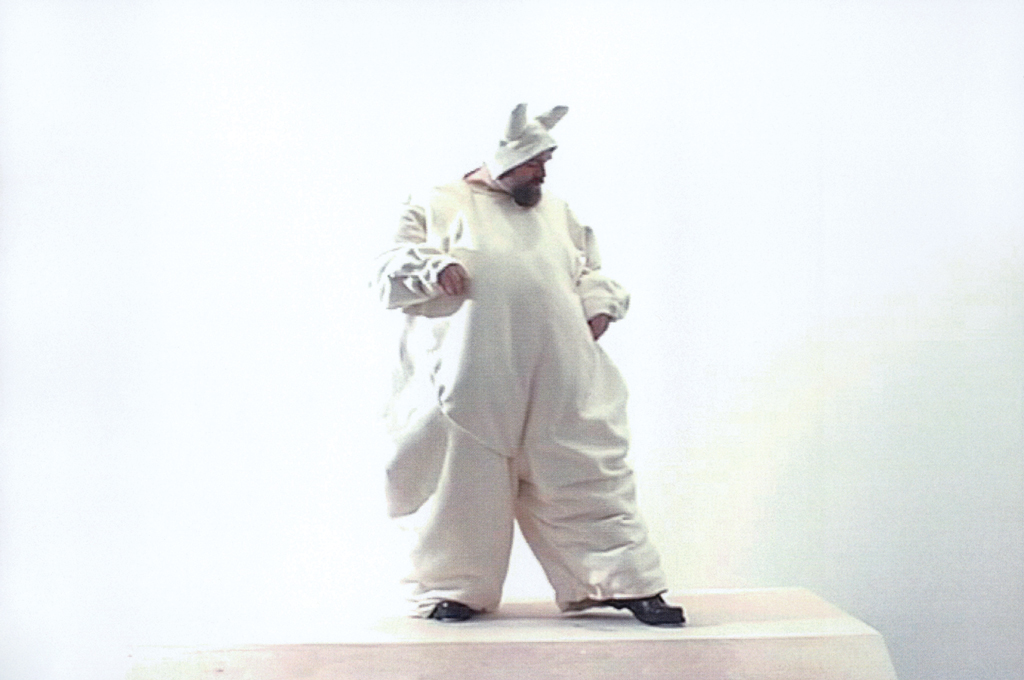 A still from Nayland Blake's Starting Over, 2000, in which the artist wears a 146-pound bunny suit.