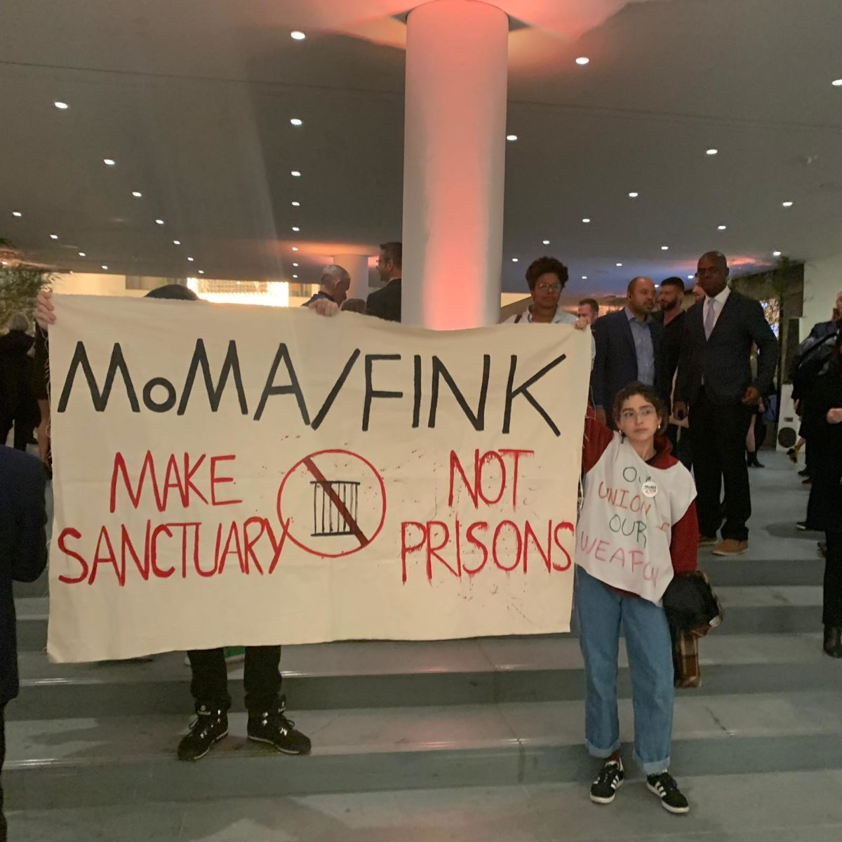 Activists Interrupt MoMA Opening Party, Urging Museum, Trustee to Cut Alleged Ties to Private Prisons -