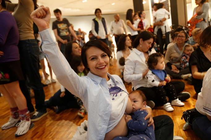 A mother raises her fist as