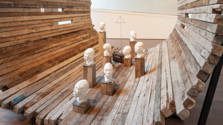 Eight white plaster busts of an