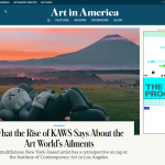 screenshot of Art in America's homepage showing a photo of a giant KAWS sculpture in a field with a sunset and mountain in the background