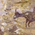 Detail of a hunting scene in a cave painting on the island of Sulawesi, Indonesia