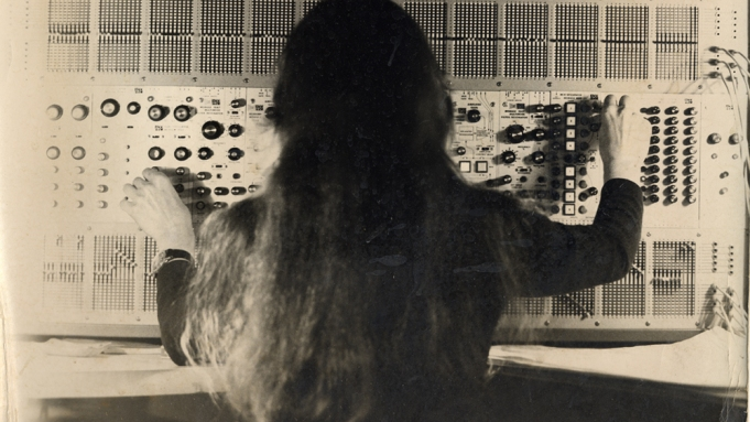 Photograph of Éliane Radigue working on