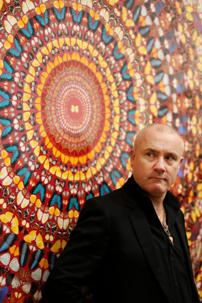 Damien Hirst in front of one